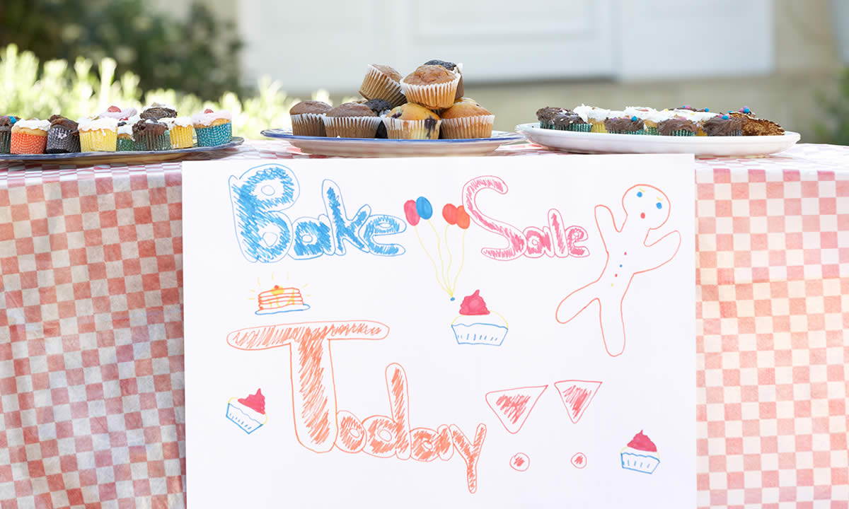 A table with cakes for a bake sale