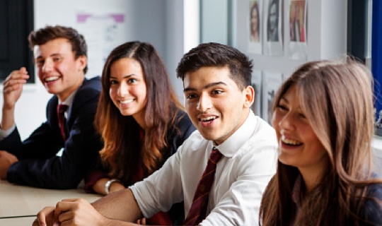 Smiling students in a classroom